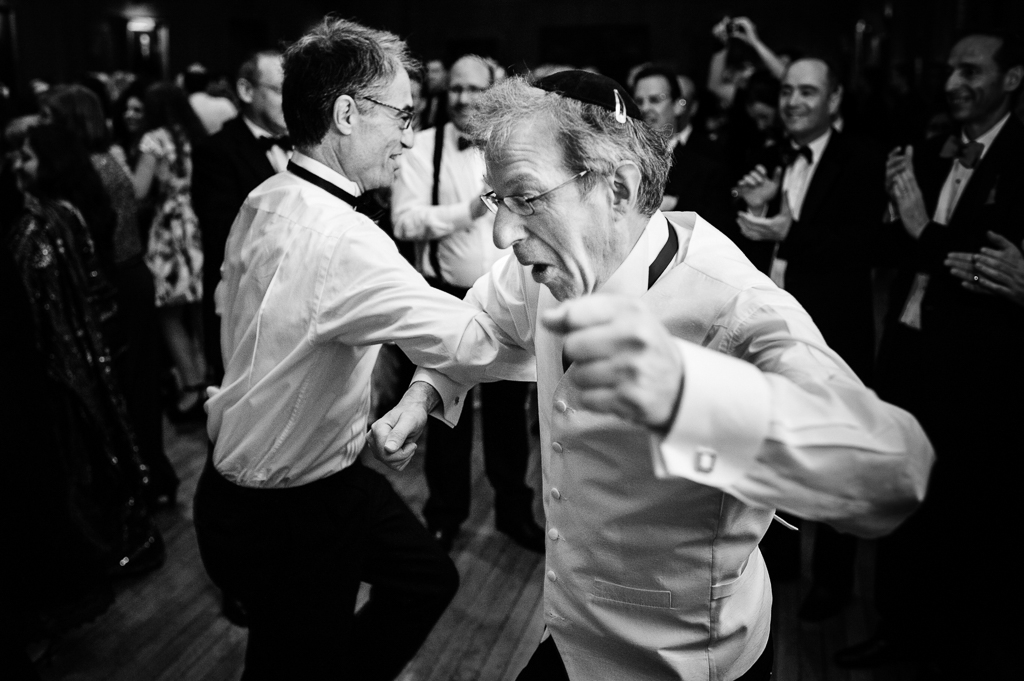 Men dancing during a wedding reception.