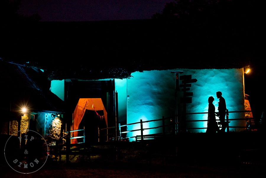 A colourful silhouette of a couple together in the evening of their wedding.