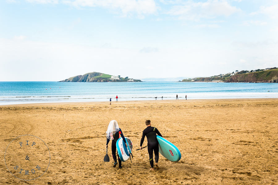 A bride and groom head to the sea for a surf before their wedding.