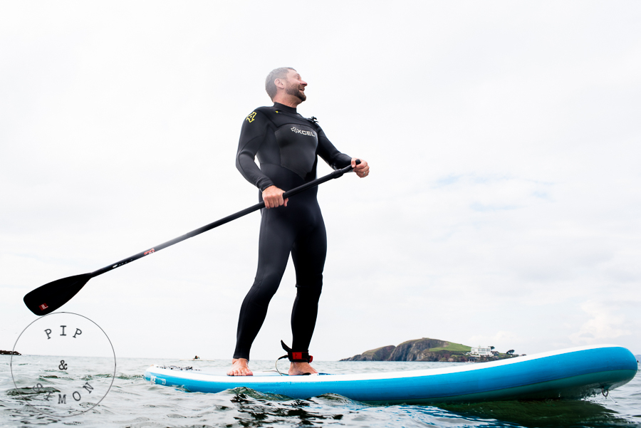 A groom on a paddleboard before his wedding.