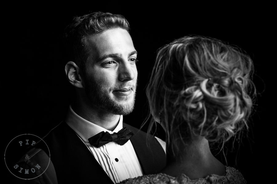 A groom looks affectionately at his bride.