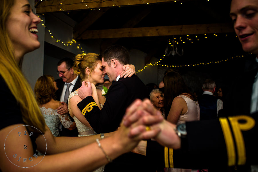 A bride and groom dance at their wedding reception