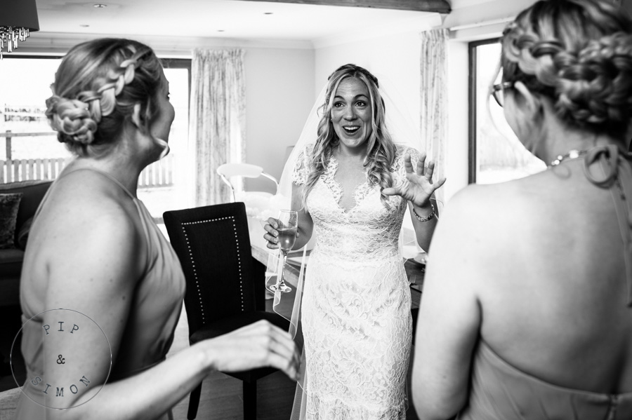 A bride is excited as she chats with bridesmaids before her wedding.