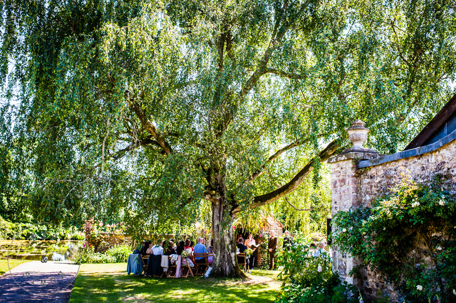 The gardens at Cadhay during a wedding ceremony.