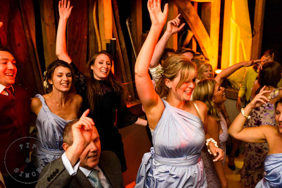 Guests dance at a wedding reception.
