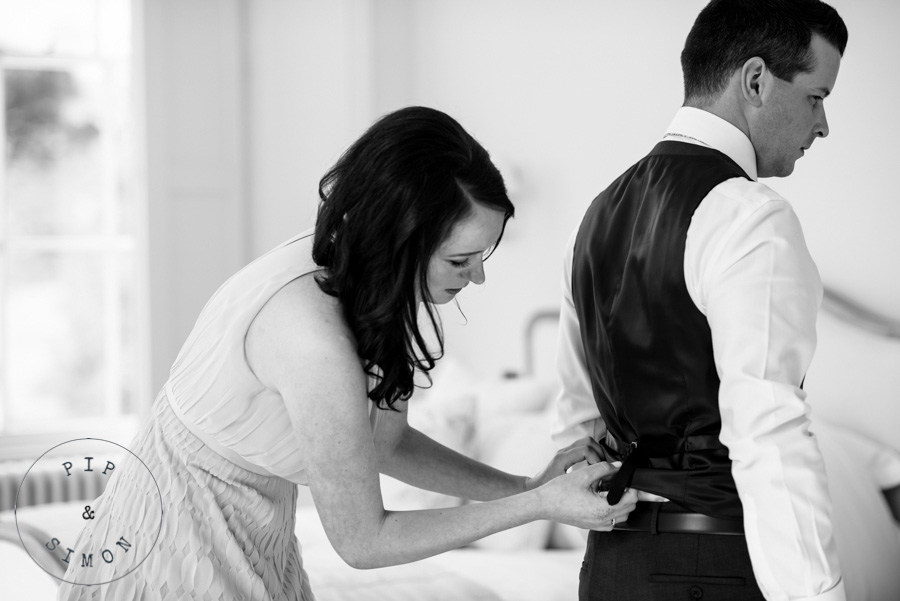 A groom gets ready for his wedding