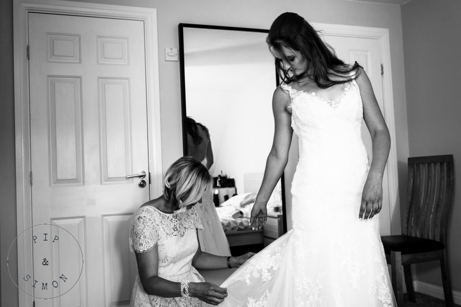 A bride gets dressed before her wedding.