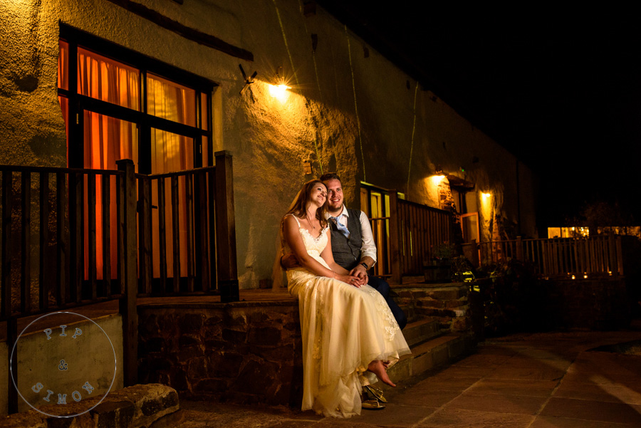 A wedding couple take a quiet moment during their evening party.