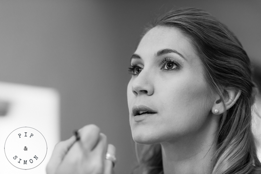 A bride has make-up applied on the morning of her wedding