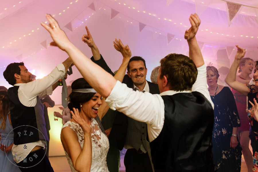 Energetic dancing at a wedding party.