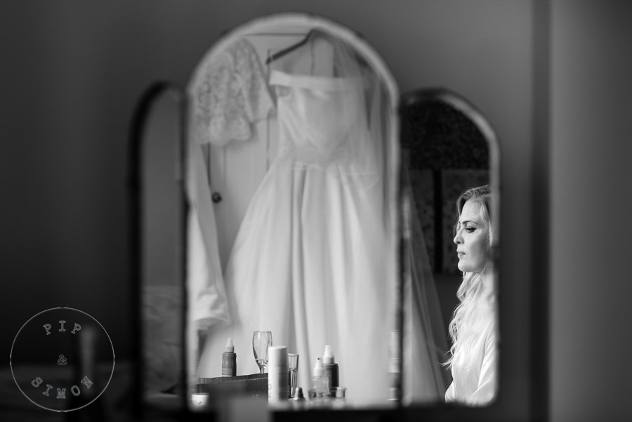 A bride looks thoughtful on the morning of her wedding.