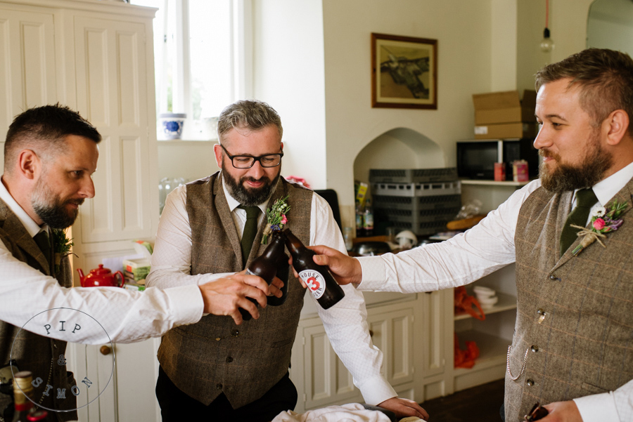 Groomsmen toast each other before a wedding.