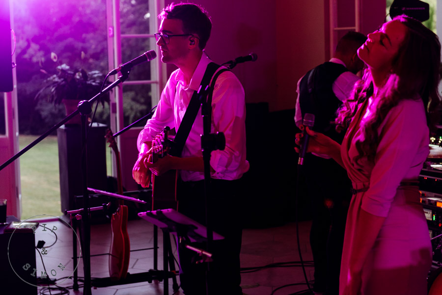 A band play during an evening wedding reception at Deer Park Country House.