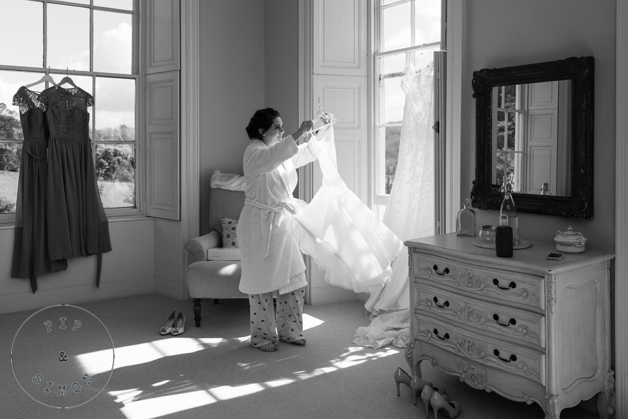 A bride gets her dress ready on the morning of her wedding.