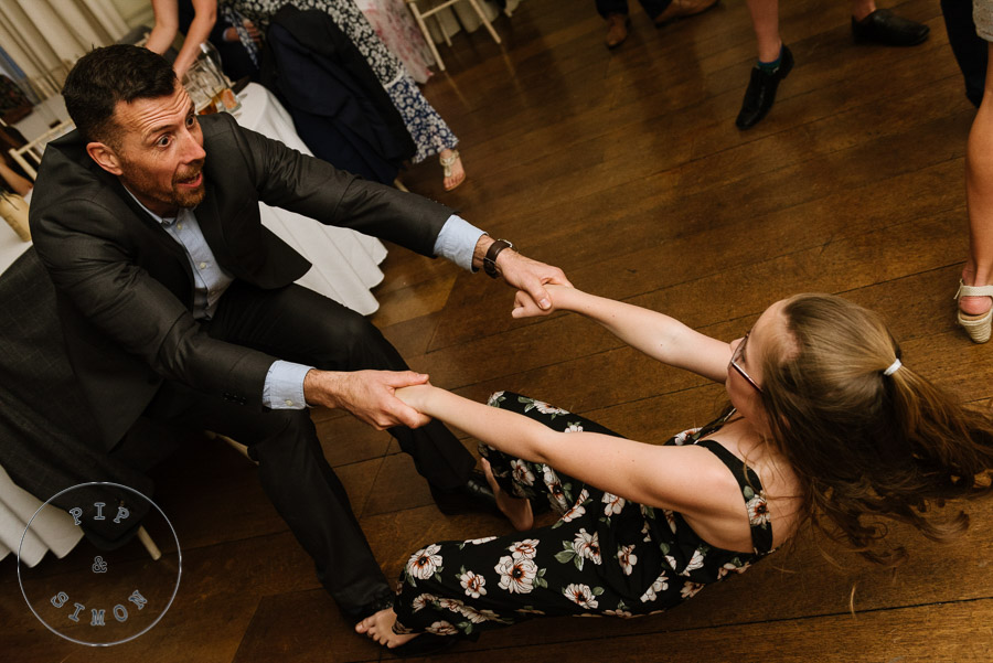A father and daughter dance together at a wedding reception.