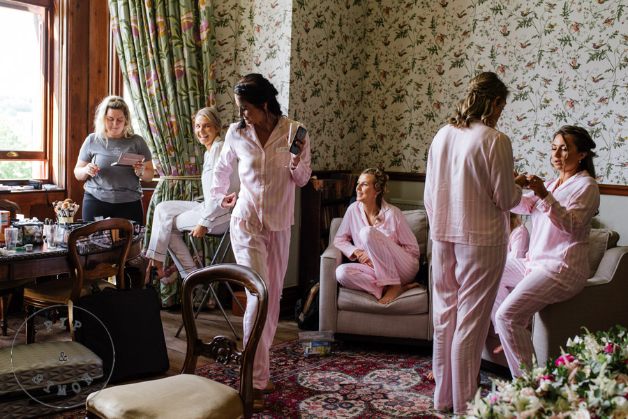 Bride and bridesmaids in pyjamas about to get ready for the wedding.