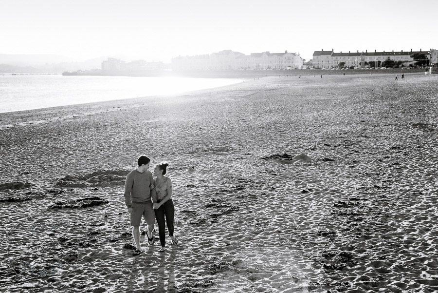 A young couple on a big beach.