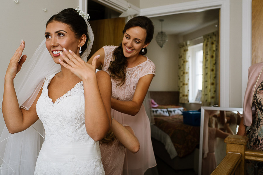 An excited bride getting ready before her wedding.