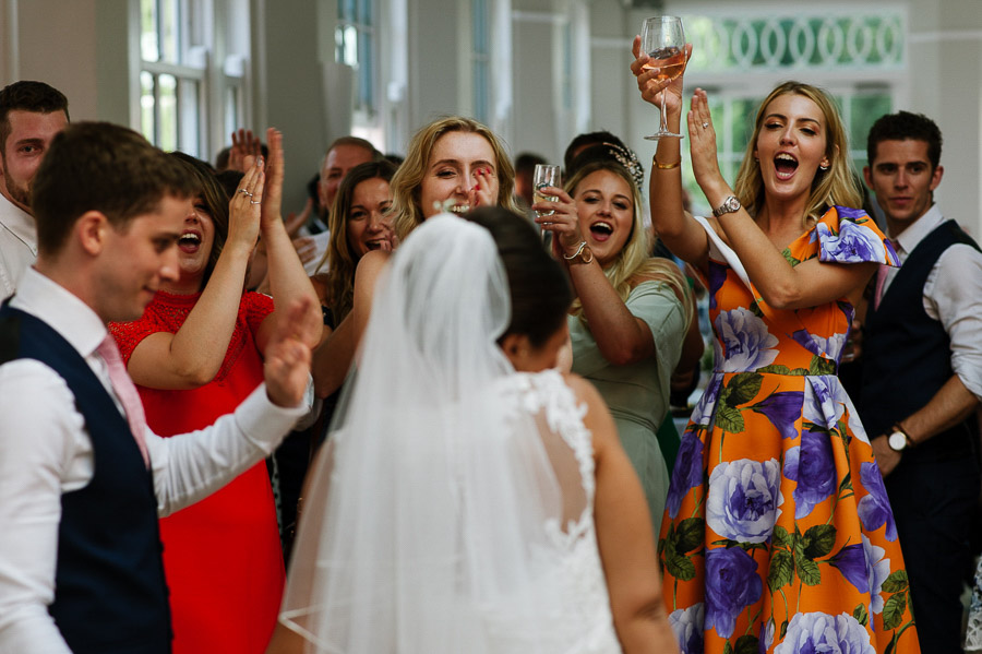 Guests clap for the Bride and Groom during an evening party.